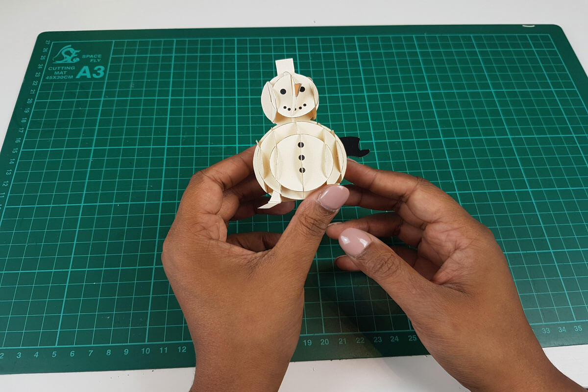 How To Make a 3D Christmas Pop Up Card - picture of the face of the snowman completed