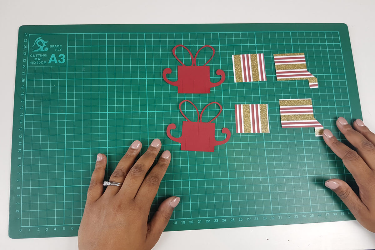 How To Make A Christmas Pop Up Card Tutorial - picture of all pieces cut out and arranged on cutting mat