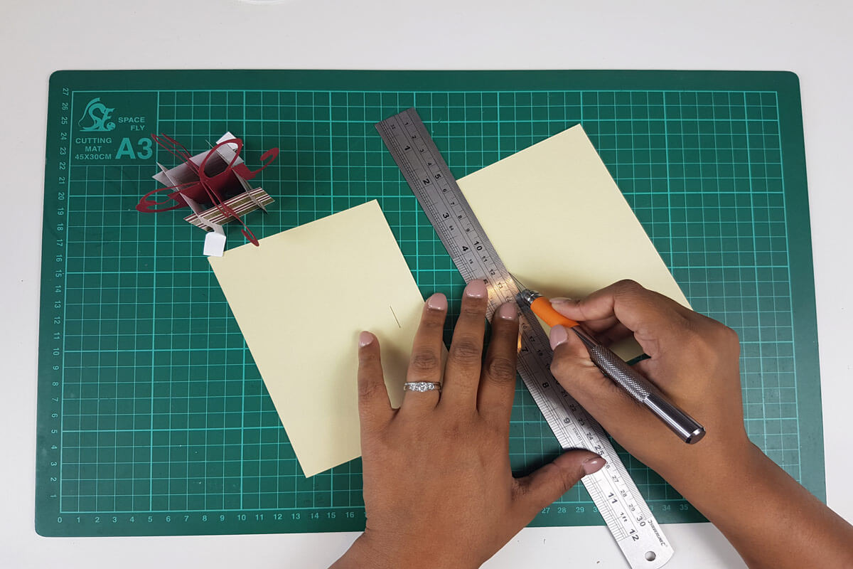 How To Make A Christmas Pop Up Card Tutorial - picture of cutting the slits in the inner cover