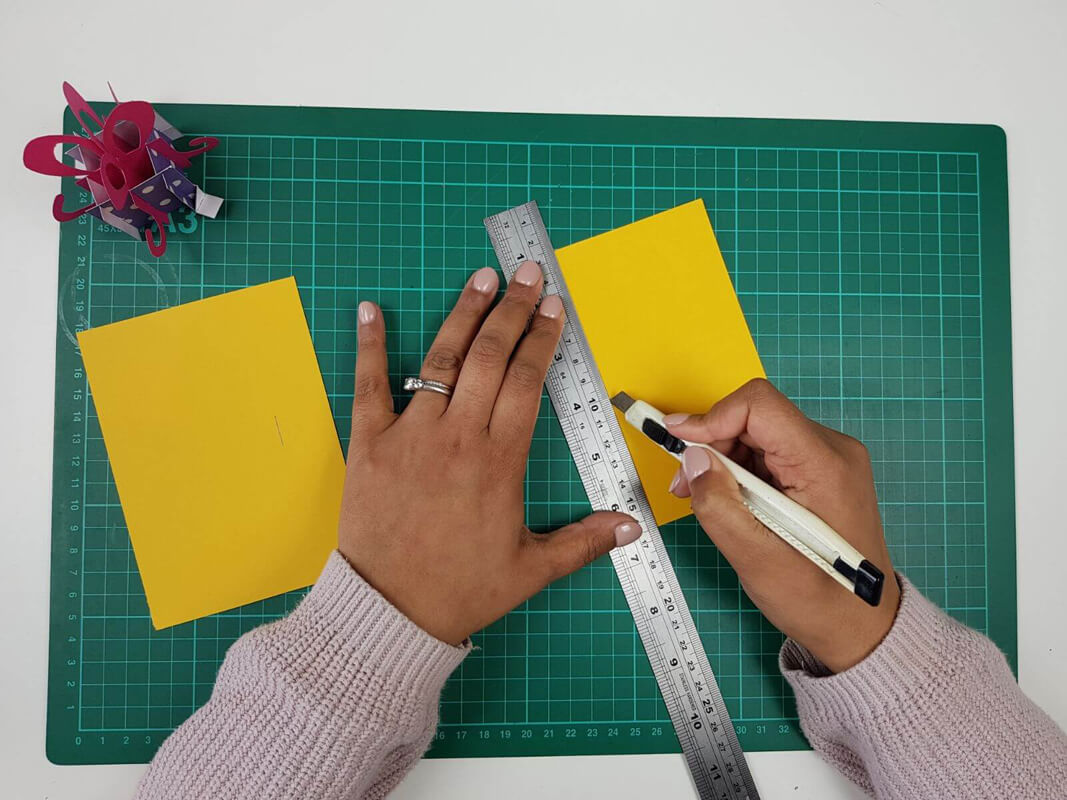 How to make a birthday card pop up card tutorial - picture of cutting the slots in the inner card covers