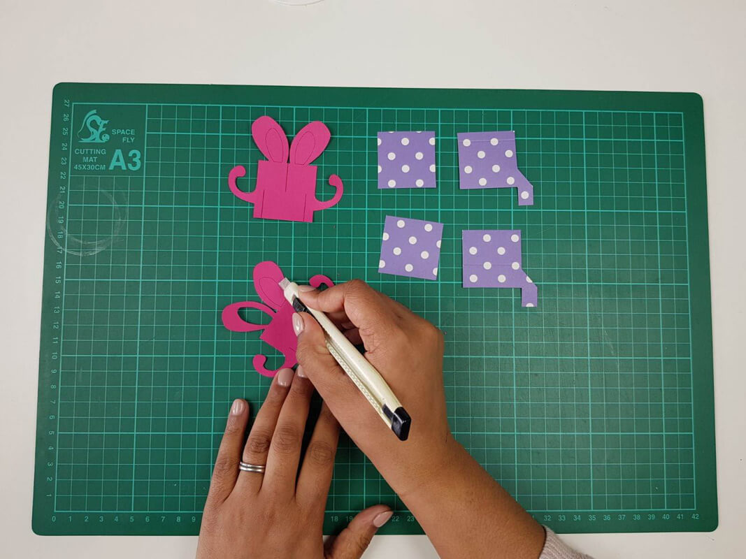 how to make a birthday pop up card tutorial - picture showing the pieces being cut out with a craft knife