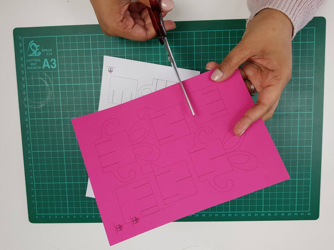 how to make a birthday pop up card tutorial - picture showing cutting of the template