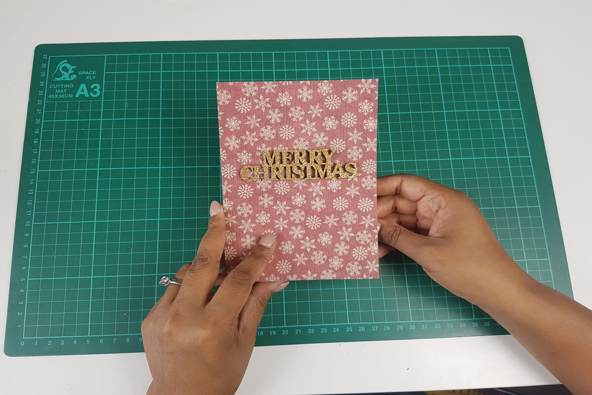 How To Make A Christmas Pop Up Card Tutorial - picture of card cover with embellishments