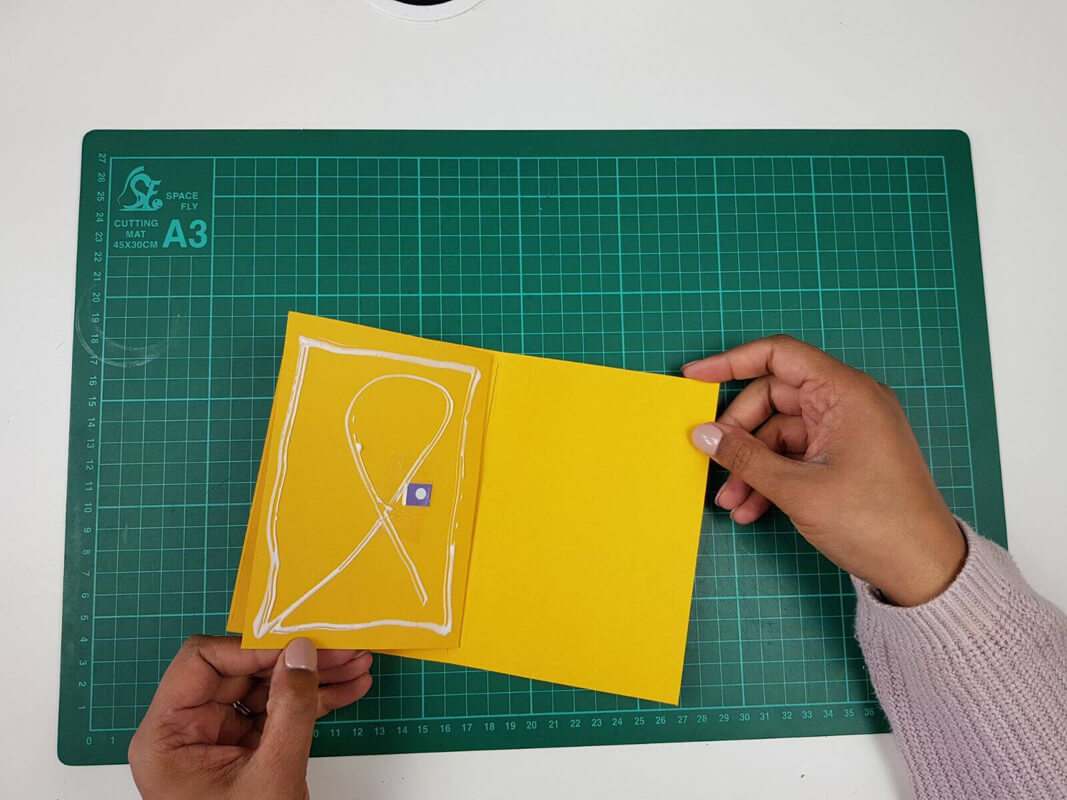 How to make a birthday card pop up card tutorial - picture of gluing the inner card to the outer cardstock