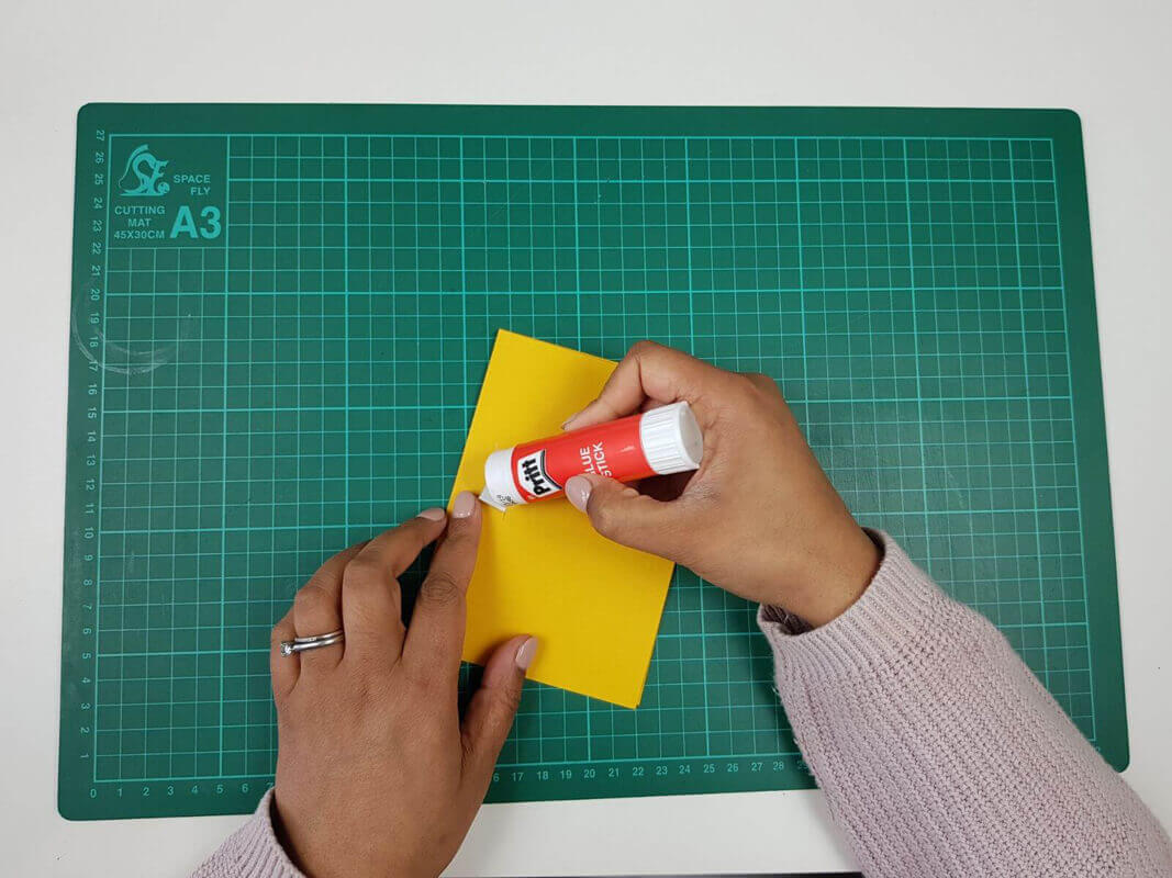 How to make a birthday card pop up card tutorial - picture of gluing the tabs to the inner card cover