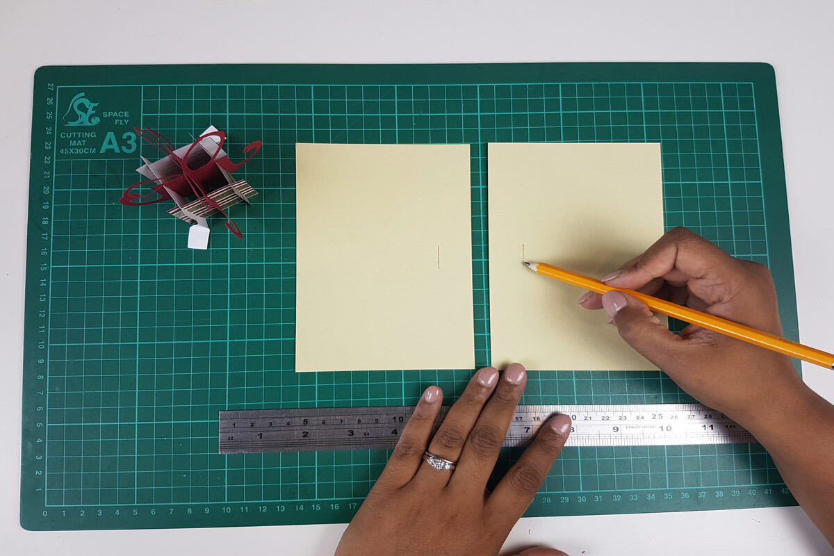 How To Make A Christmas Pop Up Card Tutorial - picture of cutting slits in the inner cover