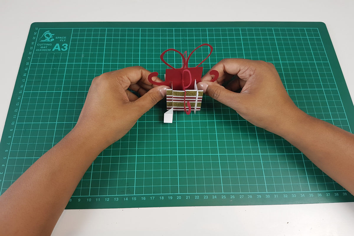 How To Make A Christmas Pop Up Card Tutorial - picture of slotting the last piece into the christmas box pop up