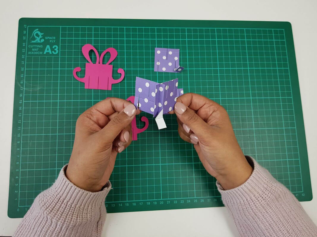 how to make a birthday pop up card tutorial - picture showing slotting the pieces together