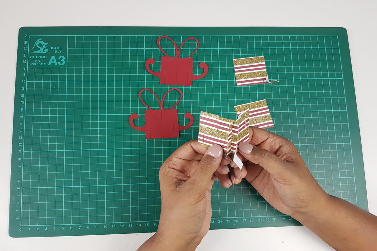 How To Make A Christmas Pop Up Card Tutorial - picture of slotting the first 2 slices together