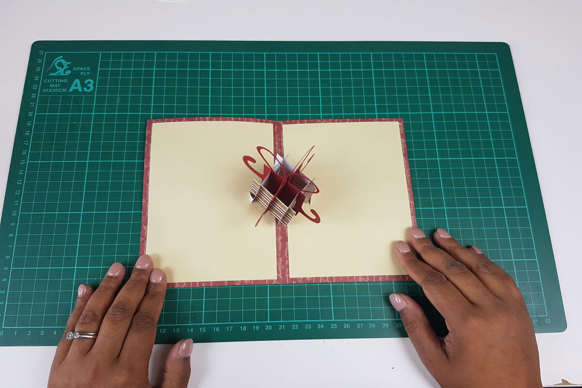 How To Make A Christmas Pop Up Card Tutorial - picture of sticking the inner cover to the outer cover