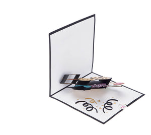 Image of 90th Birthday Card for men and women, half open at 90 degrees on a white surface
