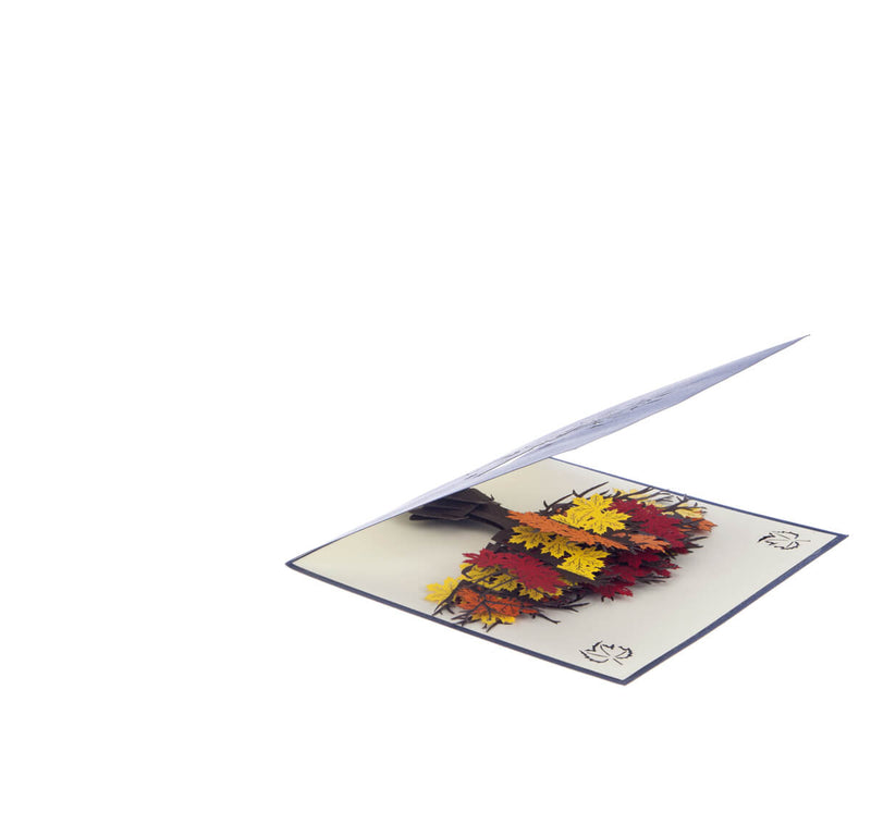 Orange, Yellow and Red Autumn Tree Pop Up Card slightly open at 45 degree angle