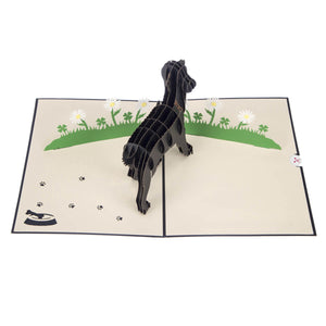 Image taken from above of Black Labradors Pop Up Card fully open