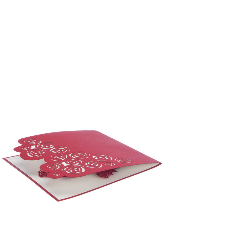 3D roses card featuring a pop up bunch of red roses for Valentine's Day, fully closed and flat on a white surface