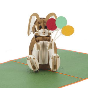 close up image of birthday bunny pop up card featuring a pop up bunny rabbit holding some balloons
