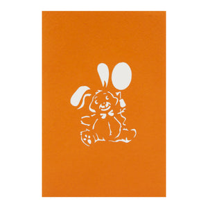 orange cover image of birthday bunny pop up card featuring a pop up bunny rabbit holding a balloon