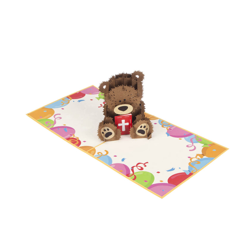 image of christening bear pop up card fully open at 180 degrees on a white surface