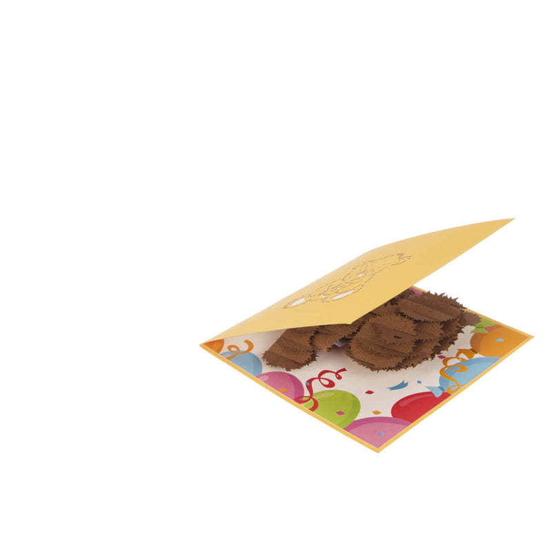 image of christening bear pop up card slightly open at 45 degrees on a white surface