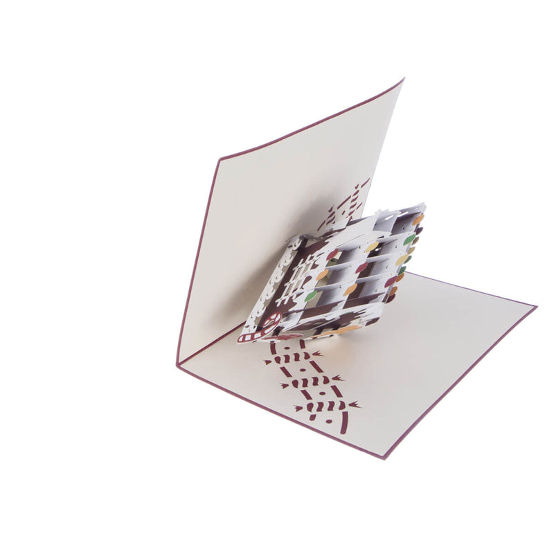 image of gingerbread house christmas card half open at 90 degrees on a white background