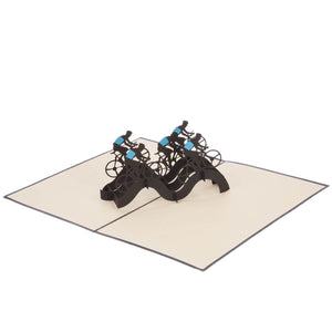 Cycling Pop Up Card featuring a 3D peloton of cyclists in black and blue, fully opened at 180 degrees