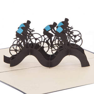 close up image of Cycling Pop Up Card featuring a 3D peloton of cyclists in black and blue