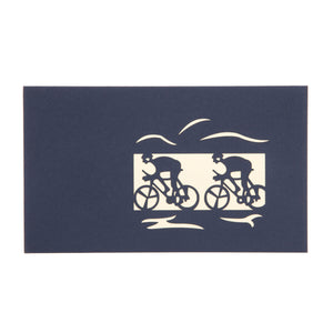 Cycling Pop Up Card cover image in blue with silhouettes of cyclists laser cut into cover