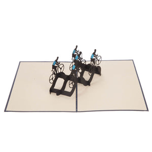 Cycling Pop Up Card featuring a 3D peloton of cyclists in black and blue, fully opened