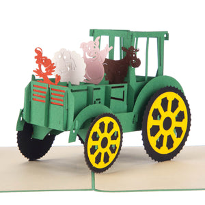 close up image of Farm Yard Animals Pop Up Card featuring a 3D John Deere tractor filled with farm animals