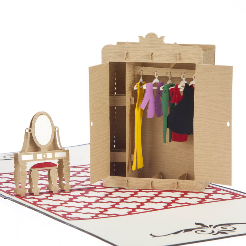 close up image of fashion lover pop up card featuring a 3D wardrobe with clothes hanging on tiny hangers inside