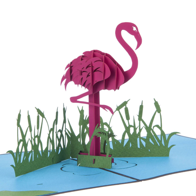 close up image of Flamingo Pop Up Card featuring a 3D vibrant pink flamingo standing in a blue lagoon