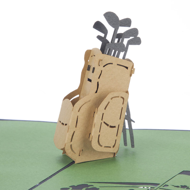 close up image of Golf Pop Up Card featuring a 3D paper golf bag full with gold clubs