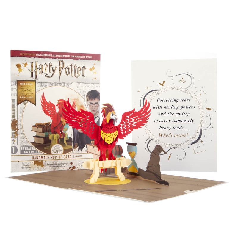 Image of Harry Potter Fawkes Pop Up Card Open with cover and packaging displayed behind