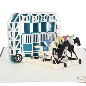 close up image of Horse Racing Pop Up Card featuring 4 horses racing out of stalls