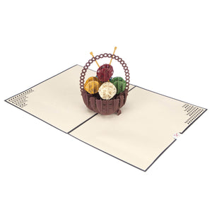 Image of Knitting Pop Up Card fully open at 180 degrees on a white surface