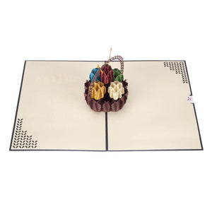 Image taken from above of Knitting Pop Up Card fully open at 180 degrees on a white surface