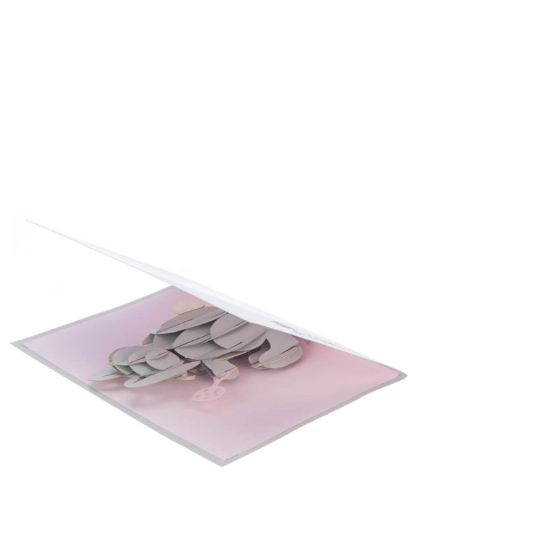 new baby girl pop up card featuring a 3D grey and white bunny holding a pink rattle, slightly opened at 45 degrees angle
