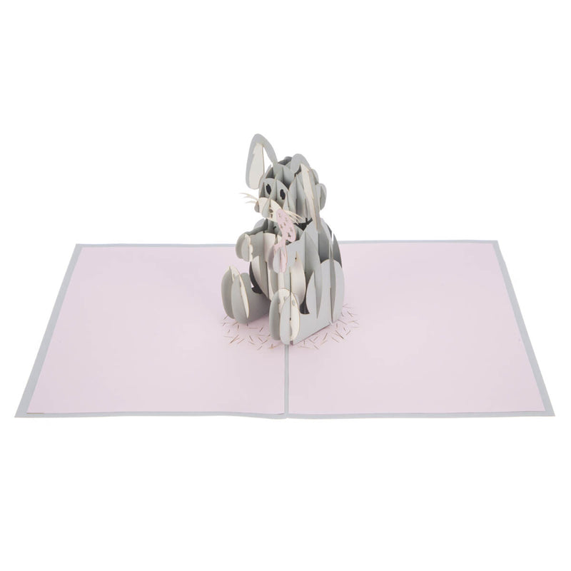 new baby girl pop up card featuring a 3D grey and white bunny holding a pink rattle, fully open