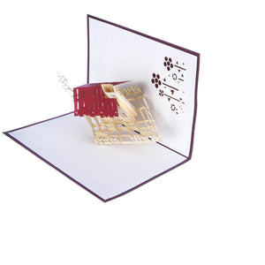 image of new home congratulations pop up card half open at 90 degrees on a white background