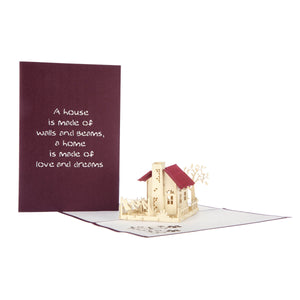 image of new home congratulations pop up card with burgandy cover behind on a white background