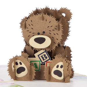 Close up image of new baby bear featuring a 3D teddy bear holding some ABC blocks