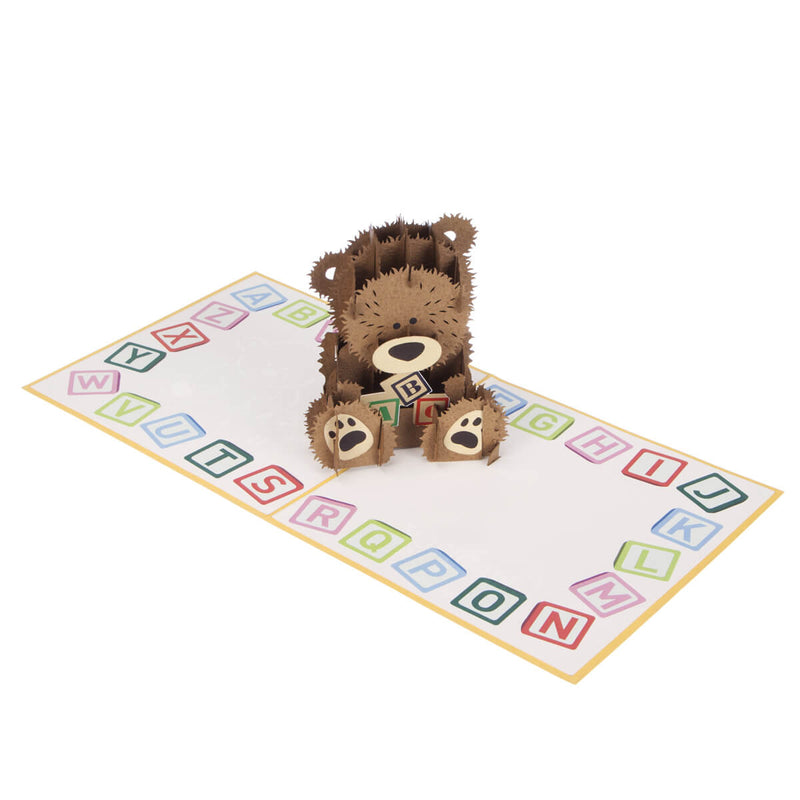 new baby bear pop up card fully open at 180 degrees on white surface