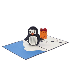 penguin pop up birthday card featuring a 3D penguin holding a birthday present, fully open at 180 degrees