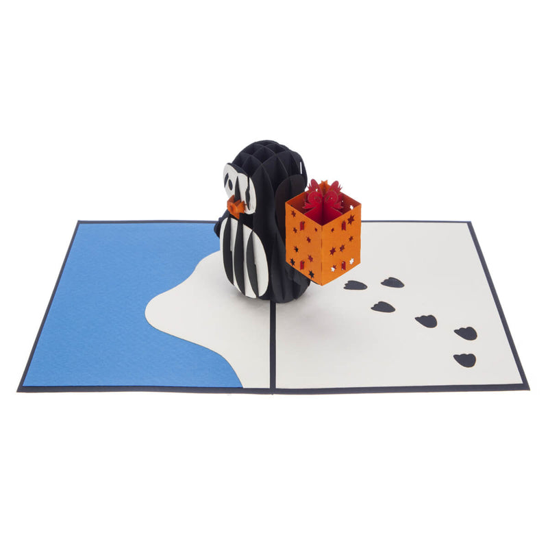 penguin pop up birthday card featuring a 3D penguin holding a birthday present, fully open