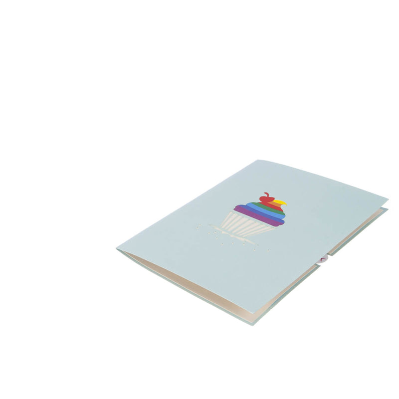 Image of Rainbow Cupcake Pop Up Card fully closed and flat on white surface