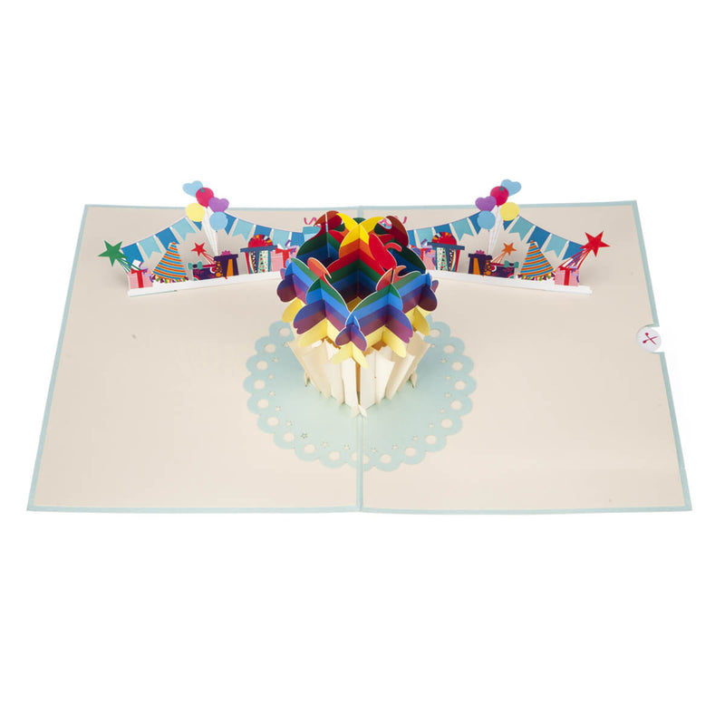 Image taken from above of Rainbow Cupcake Pop Up Card fully open at 180 degrees
