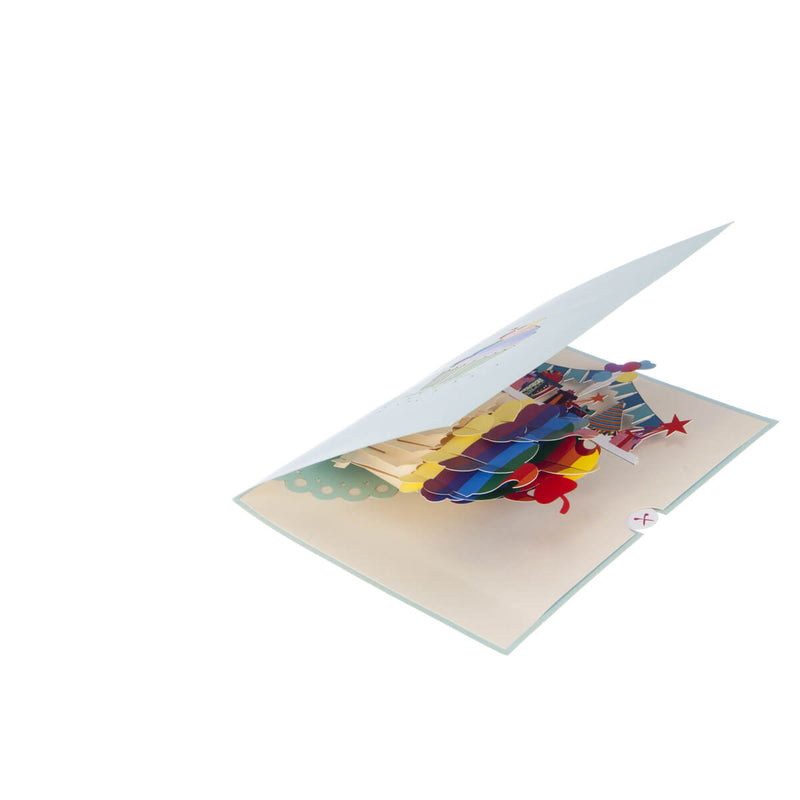 Image of Rainbow Cupcake Pop Up Card slightly open at 45 degrees on white surface