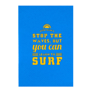 close up image of surfing pop up card blue cover which reads