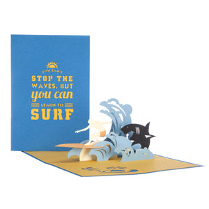 image of surfing pop up card fully open with cover behind
