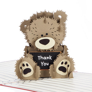 Close up image of Thank You Teacher Pop Up Card featuring a 3D brown fluffy bear holding a chalk board with Thank You written on it