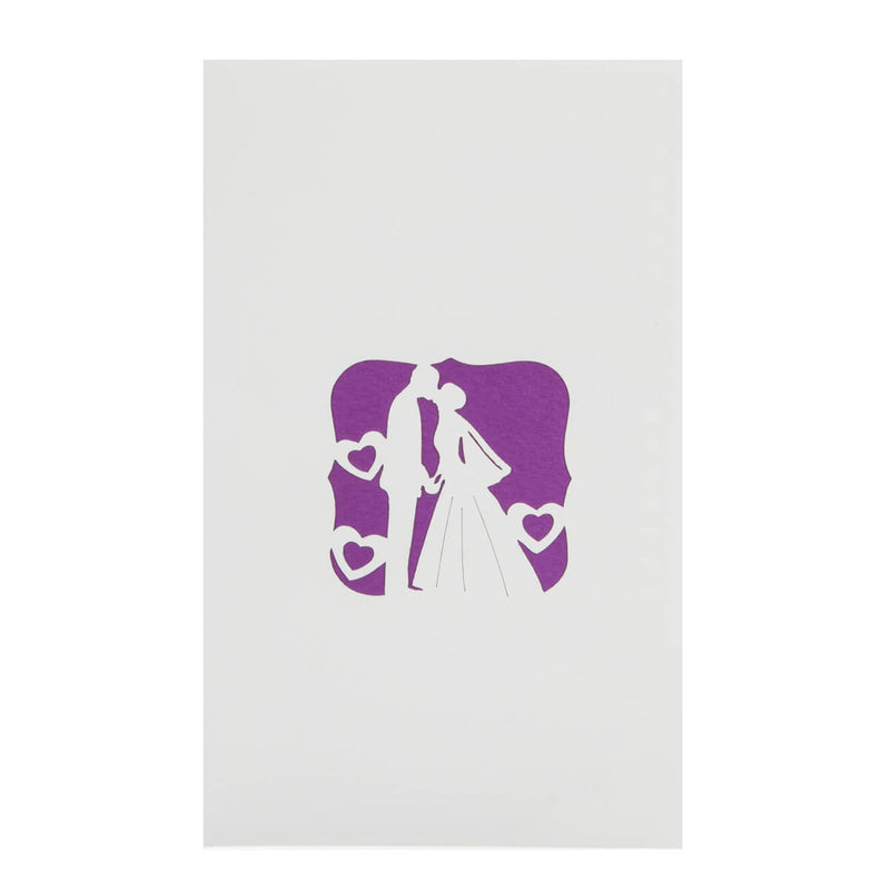 image of ivory bride and groom pop up card cover featuring a purple motif of a newly wed couple sharing a kiss
